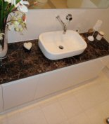 counter top basin with marble bench top